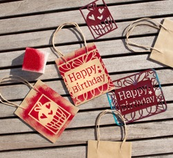 happy birthday stencil. Templates for stamping. Decoration of paper bags.