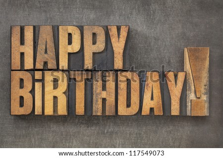 Happy Birthday! -  text in vintage letterpress wood type blocks on a grunge metal background