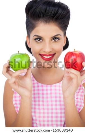 Happy black hair woman holding apples on white background