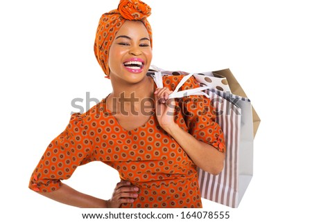 happy black woman carrying shopping bags over white background