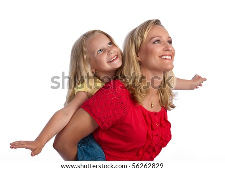 Happy, blond caucasian mother and daughter, piggybacking and smiling, arms out