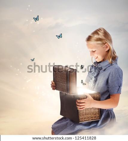 Happy Blond Girl Opening a Treasure Box