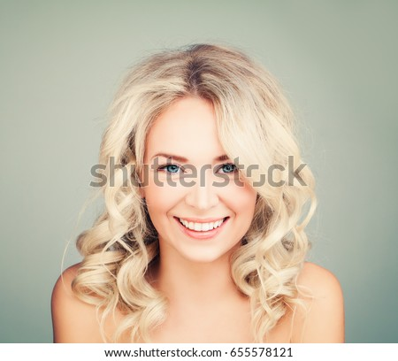 Shutterstock Happy Blonde Woman with Blonde Curly Hair. Smiling Fashion Model with Wavy Hairstyle