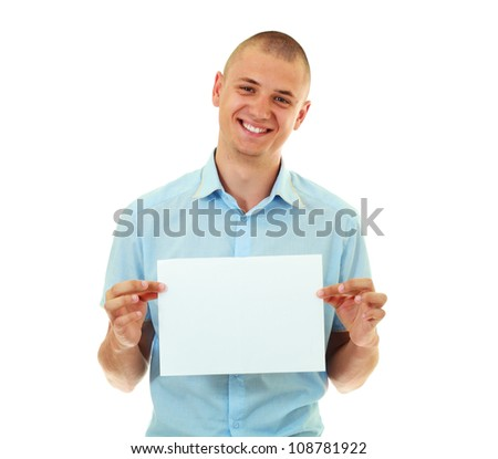 Happy bold young man holding blank card against white background