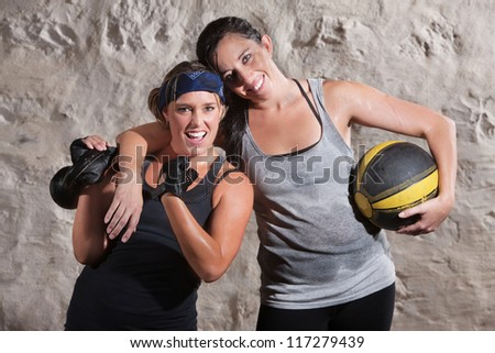 Happy boot camp training partners with weight and medicine ball