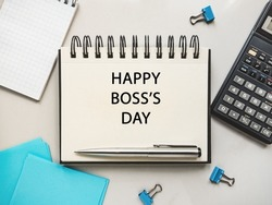 Happy Boss Day. Notepad and stationery lying on the table. Close-up, view from above, no people. Congratulations for loved ones, relatives, friends and colleagues. Holiday concept