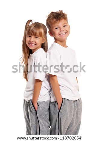 Happy boy and little girl standing back to back isolated on white background