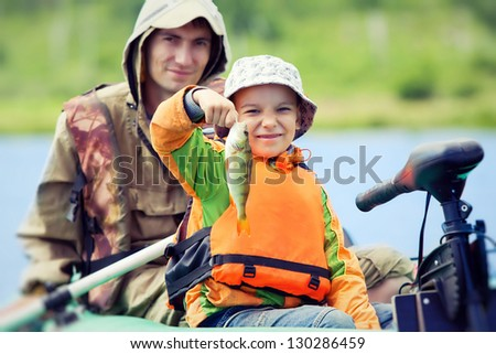 Happy boy catches his first fish