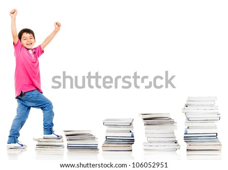 Happy boy climbing in his education - isolated over a white background
