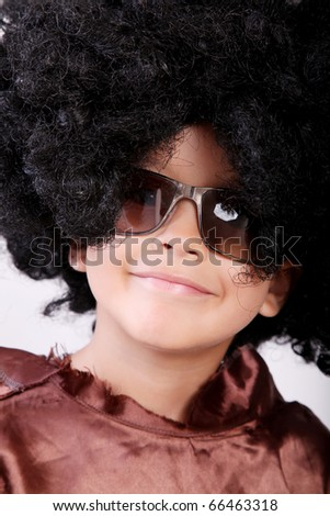 Happy boy disguised in a wig and glasses
