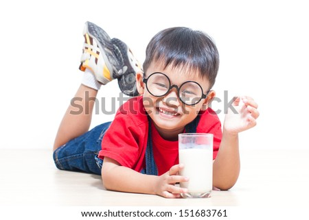 Happy boy drink milk isolated on white
