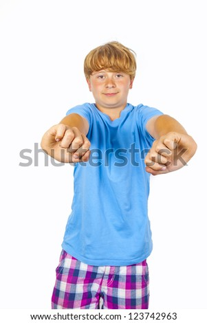 happy boy gestures with his arms with a white wall background