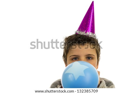 happy boy having a party,blowing up a balloon.