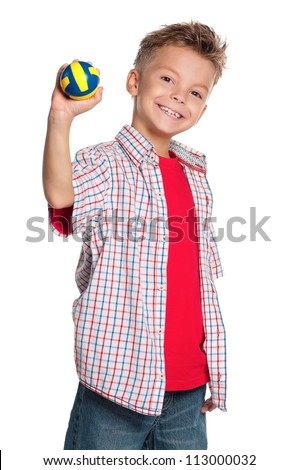 Happy boy holding small volleyball ball in hand isolated on white background
