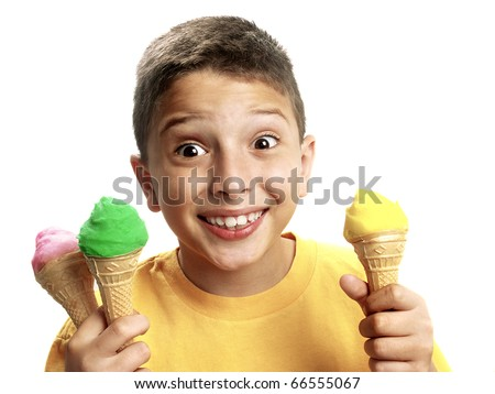 Happy boy holding three ice cream cones.