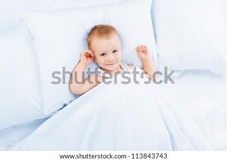 Happy boy in bed