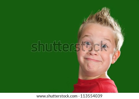 happy boy in front of green background
