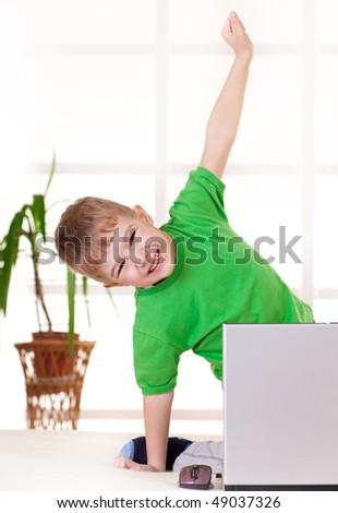 stock-photo-happy-boy-in-front-of-laptop-49037326.jpg