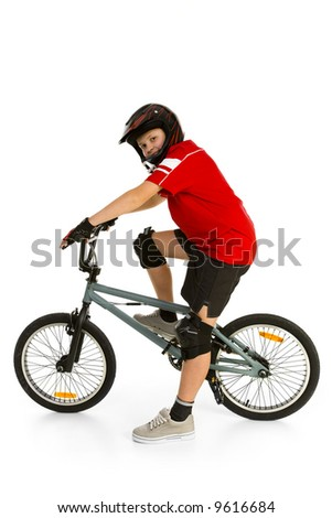 Happy boy in helmet on BMX and looking at camera. Side view. Isolated on white background.