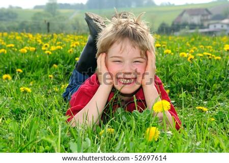 happy boy in springtime landscape