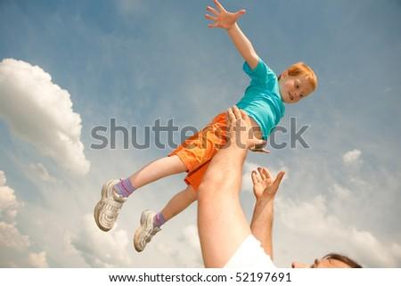 Happy boy jumping the field