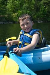 Happy boy kayaking