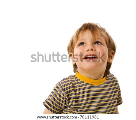 Happy Boy looking up laughing isolated on white