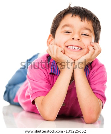 Happy boy lying on the floor and smiling - isolated over white