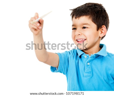 Happy boy painting with a brush - isolated over a white background
