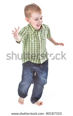 happy boy running over white background