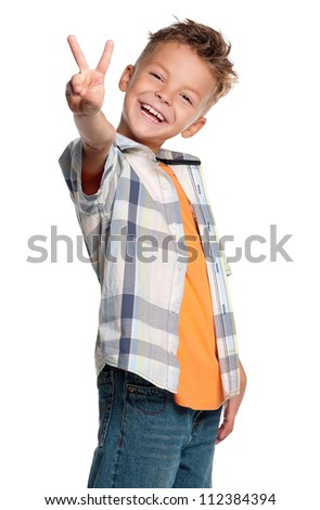 Happy boy showing victory sign isolated on white background