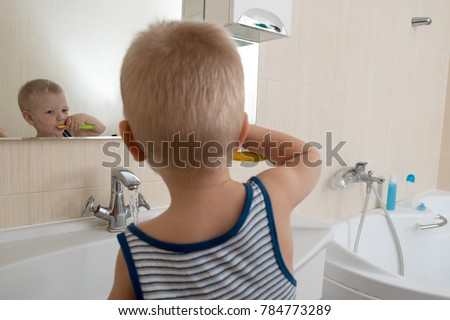 Free photos Adorable little toddler boy taking a bath in bathtub ...
