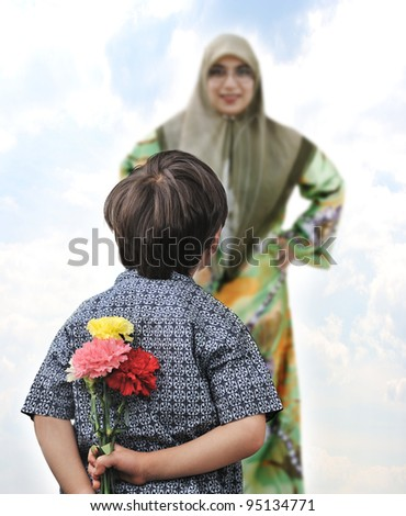 Happy boy with a bouquet of tulips  for his mother - stock photo