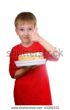 "Happy boy with a cake shows the sign ""OK"" on a white background"