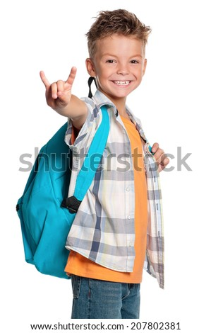 Happy boy with backpack showing rock and roll sign, isolated on white background Foto stock ©