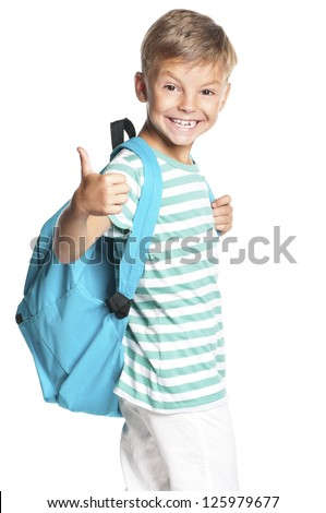 Happy boy with backpack showing thumbs up isolated on white background