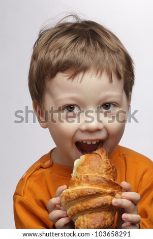 happy boy with  croissant