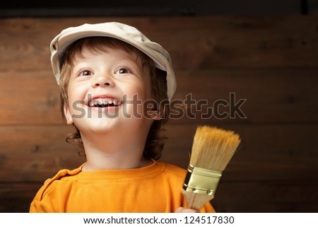 happy boy with paint brush