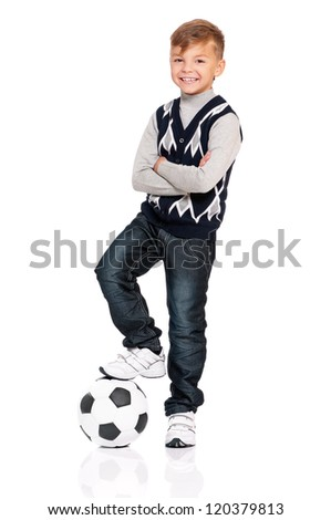 Happy boy with soccer ball isolated on white background