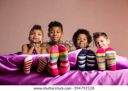Happy boys in colorful socks. Cheerful boys sitting on bed. Cherish your friendship. When we were young.
