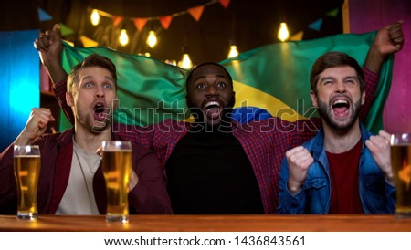 Happy brazilian soccer fans cheering for team winning championship, results #1436843561