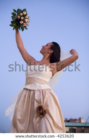 happy bride about to throw the wedding bouquet - stock photo