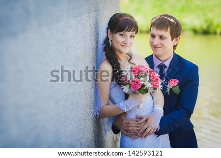 happy bride and groom are hugging on stairs #142593121