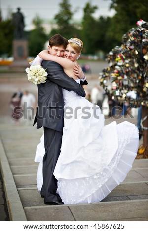 Happy bride and groom at a wedding a walk on bridge