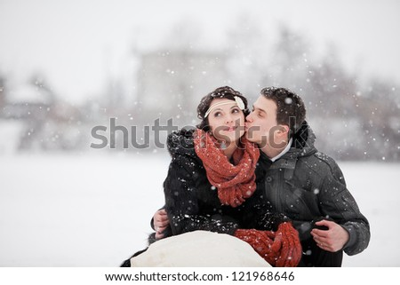 Happy bride and groom in winter day