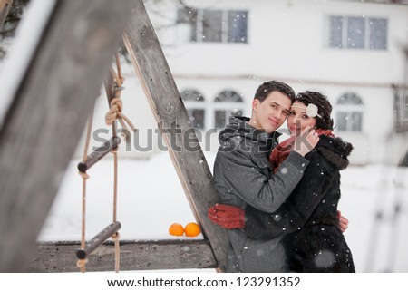 Happy bride and groom in winter day on their wedding