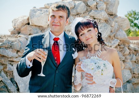 happy bride and groom with champagne - stock photo