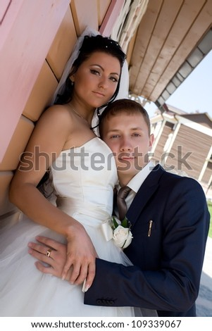 Happy bride and groom with flowers