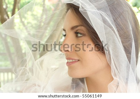 Happy bride: beautiful girl with tulle veil outdoors, park, summer