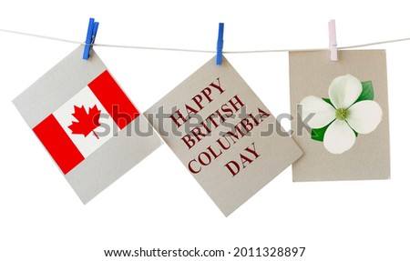 Happy British Columbia Day. Holiday greeting cards with Pacific dogwood flower - Floral emblem of B.C. and Canadian national flag. Festive cards hanging on the rope isolated on white Foto stock ©
